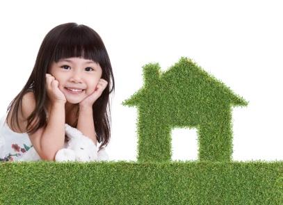 green grass house with cute little girl
