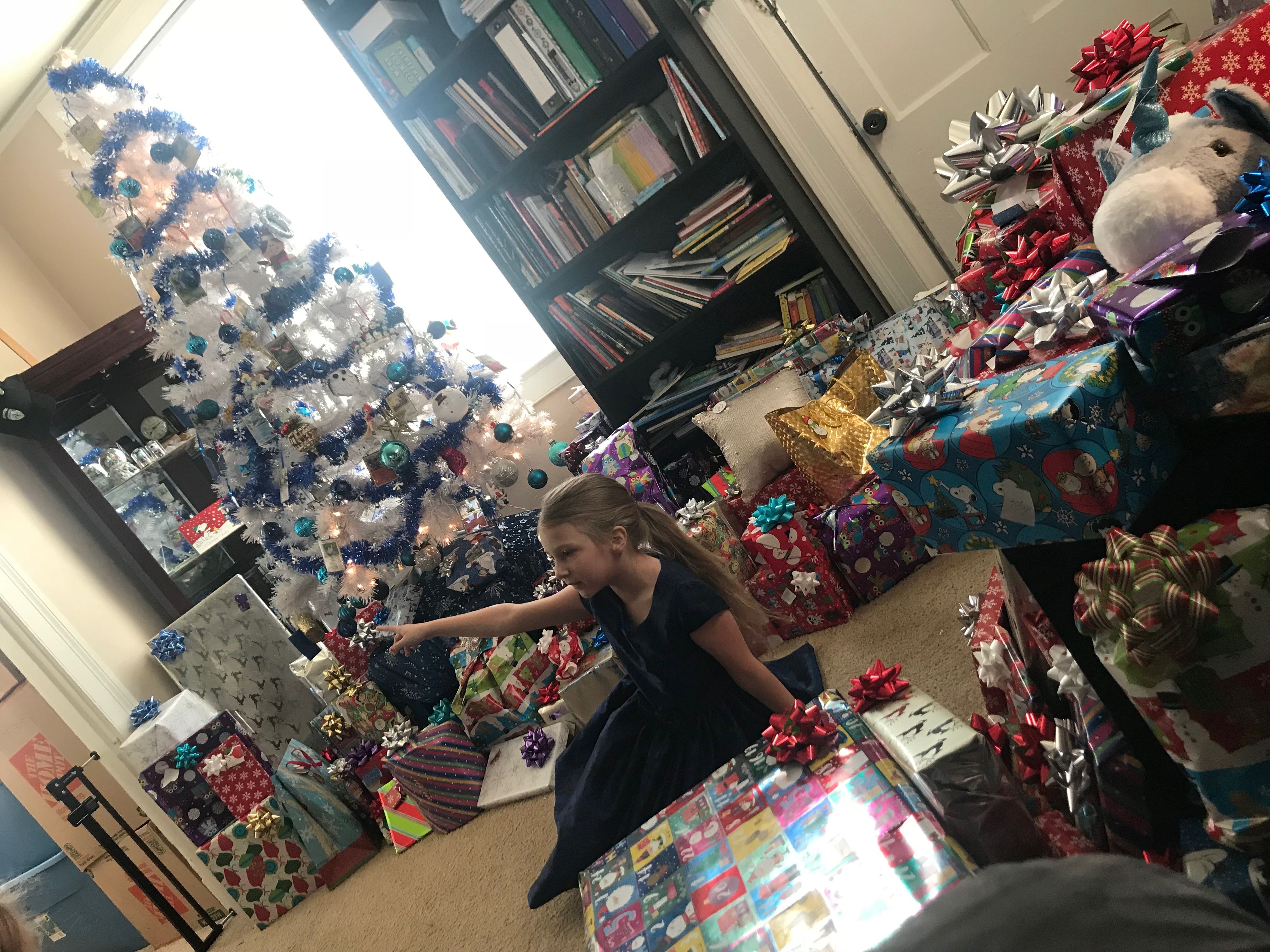 Christmas morning - Too many gifts? Science shows less toys is better for kids.